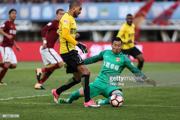 Alan of Guangzhou Evergrande dribbles past Yang Cheng of Hebei China Fortune during the Chinese Super League match between Hebei China Fortune and...
