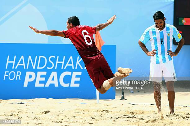Alan of Portugal celebrates a goal as Federico Costas of Argentina reacts during the FIFA Beach Soccer World Cup Portugal 2015 Group A match beween...