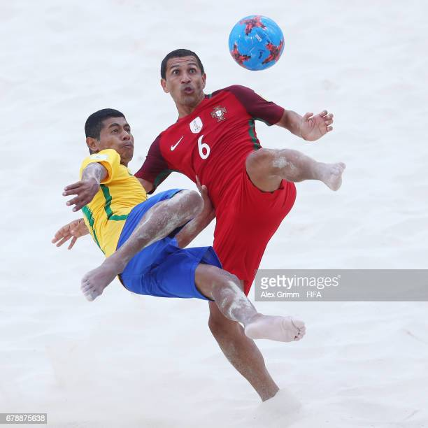 Alan of Portugal is challenged by Datinha of Brazil during the FIFA Beach Soccer World Cup Bahamas 2017 quarter final match between Brazil and...
