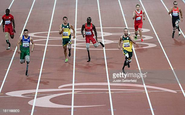 Alan Oliveira Cardoso Oliveira of Brazil leads Oscar Pistorius of South Africa in the Men's 200m - T44 final on Day 4 of the London 2012 Paralympic...