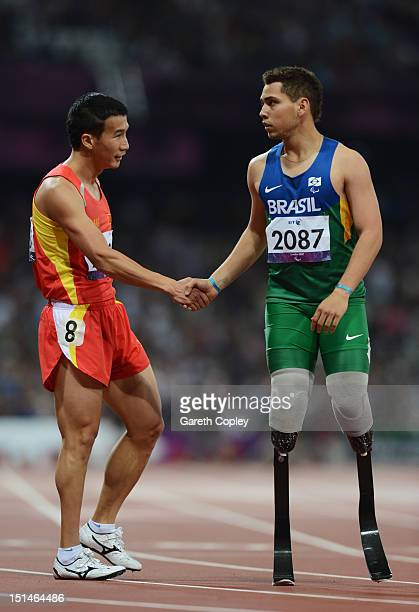 Alan Oliveira Cardoso Oliveira of Brazil shakes hands with Zhiming Liu of China after the Men's 400m T44 heats on day 9 of the London 2012 Paralympic...