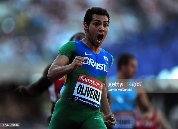 Alan Oliveira of Brazil celebrates as he wins in the Men's T43/44 100mduring day three of the Sainsbury's Anniversary Games IAAF Diamond League 2013...