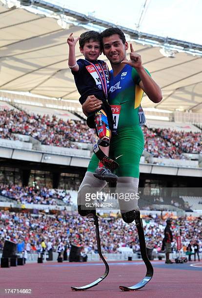 Alan Oliviera of Brazil poses with young British meningitis victim Rio Woolfe 5 after he won the mens T43/44 100 metres event during the...