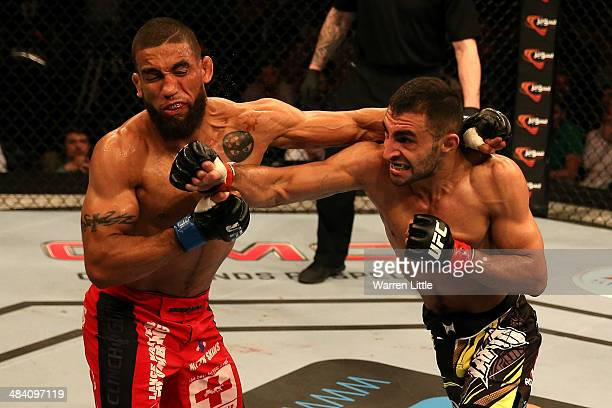 Alan Omer connects with a right to the face of Jim Alers during their bout during UFC Fight Night 39 at du Arena on April 11, 2014 in Abu Dhabi,...