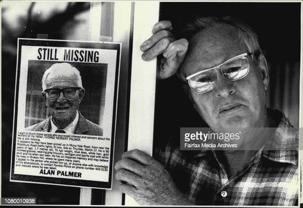 Alan Palmer 60 and X one of the posters he has made appealing for information about his missing father George Palmer 90 June 19 1988