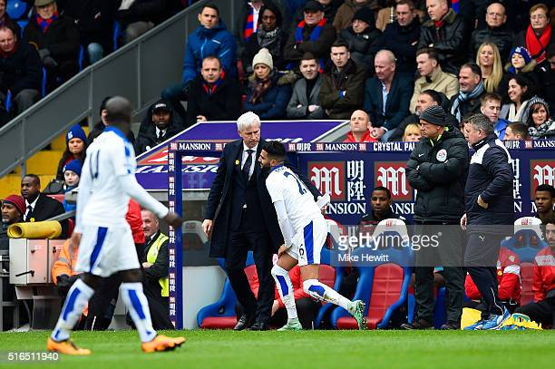 Alan Pardew Manager of Crystal Palace and Riyad Mahrez of Leicester City are seen during the Barclays Premier League match between Crystal Palace and...