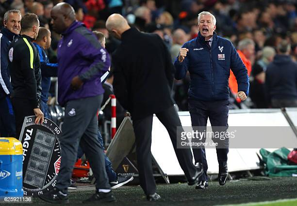 Alan Pardew Manager of Crystal Palace celebrates his team's third goal during the Premier League match between Swansea City and Crystal Palace at...