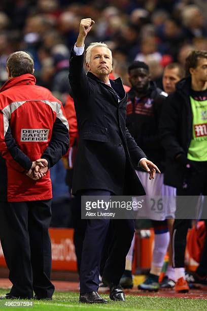 Alan Pardew Manager of Crystal Palace celebrates towards the fans following the Barclays Premier League match between Liverpool and Crystal Palace at...