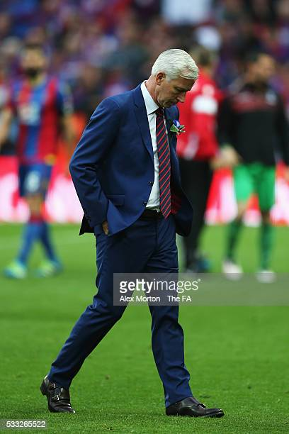 Alan Pardew Manager of Crystal Palace looks dejected after The Emirates FA Cup Final match between Manchester United and Crystal Palace at Wembley...