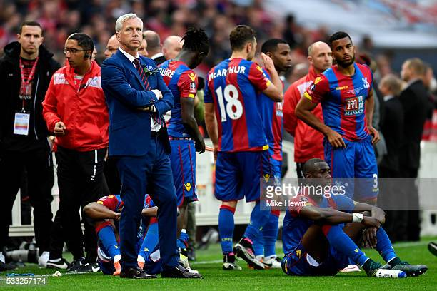Alan Pardew manager of Crystal Palace looks dejected in defeat after The Emirates FA Cup Final match between Manchester United and Crystal Palace at...