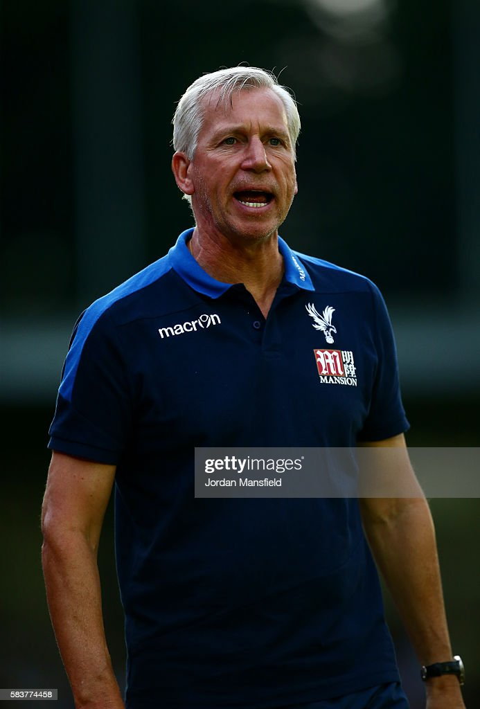 Alan Pardew, manager of Crystal Palace looks on during the pre-season friendly between AFC Wimbledon and Crystal Palace at The Cherry Red Records Stadium on July 27, 2016 in Kingston upon Thames, England.