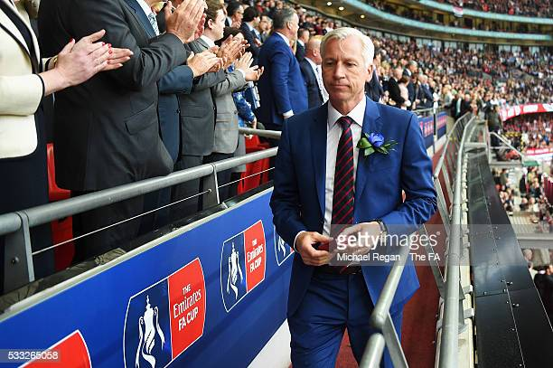 Alan Pardew Manager of Crystal Palace receives the runners-up medal during The Emirates FA Cup Final match between Manchester United and Crystal...