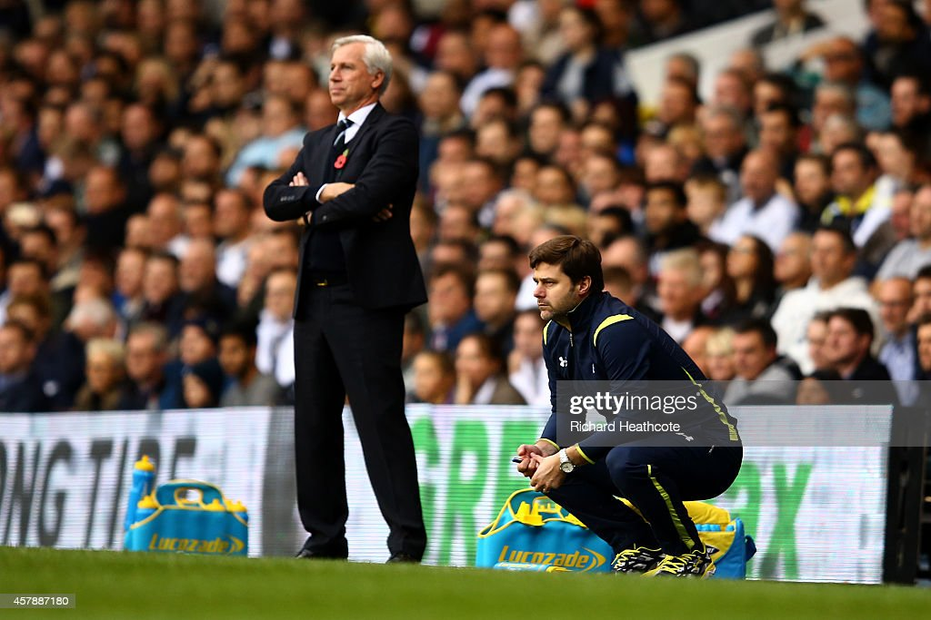 Alan Pardew, manager of Newcastle United and Mauricio Pochettino, manager of Spurs look on during the Barclays Premier League match between Tottenham Hotspur and Newcastle United at White Hart Lane on October 26, 2014 in London, England.