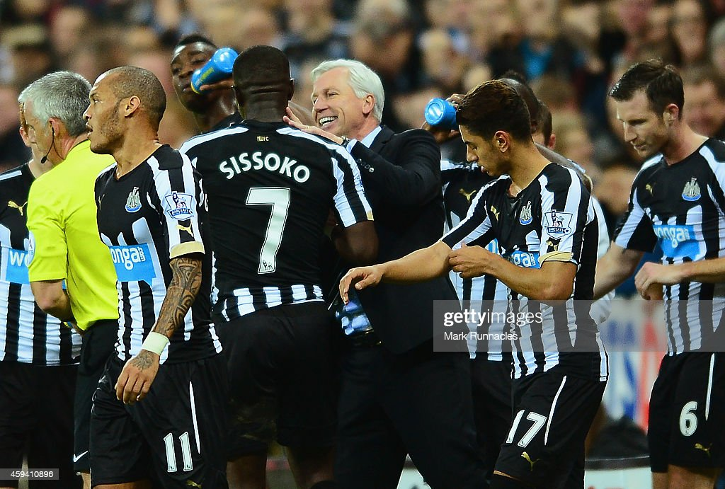 Alan Pardew manager of Newcastle United congratulates Moussa Sissoko of Newcastle United on scoring the opening goal during the Barclays Premier League match between Newcastle United and Queens Park Rangers at St James' Park on November 22, 2014 in Newcastle upon Tyne, England.