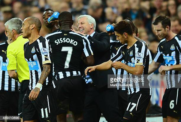 Alan Pardew manager of Newcastle United congratulates Moussa Sissoko of Newcastle United on scoring the opening goal during the Barclays Premier...