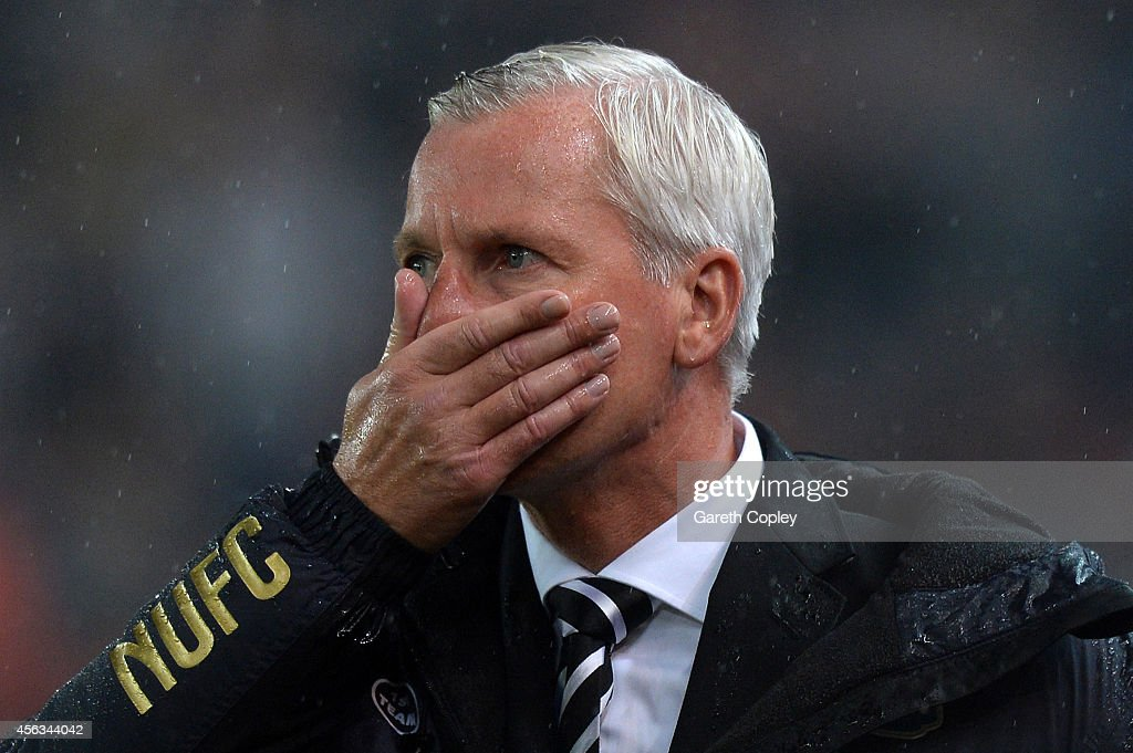 Alan Pardew manager of Newcastle United looks on during the Barclays Premier League match between Stoke City and Newcastle United at Britannia Stadium on September 29, 2014 in Stoke on Trent, England.