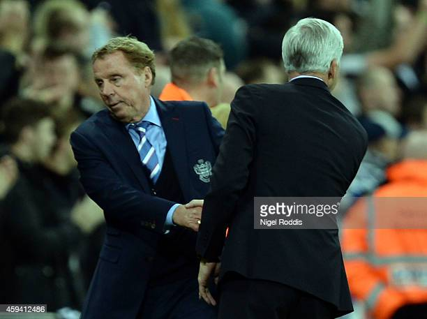 Alan Pardew manager of Newcastle United reacts with Harry Redknapp manager of Queeens Park Rangers during the Barclays Premier League football match...