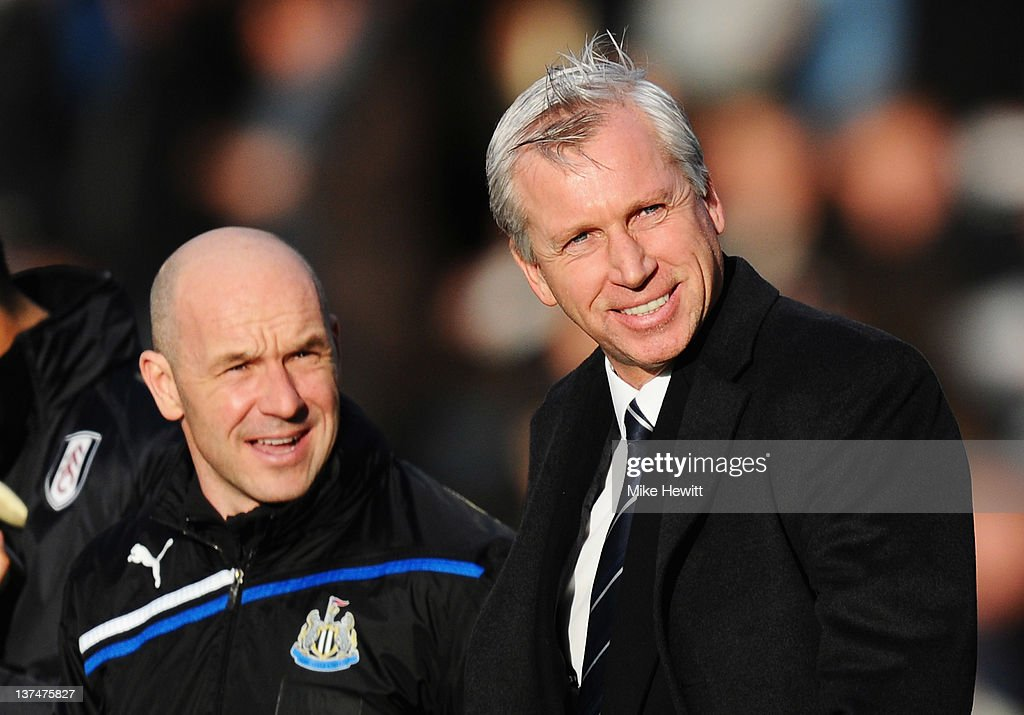 Alan Pardew (R), manager of Newcastle United smiles with Steve Stone prior to the Barclays Premier League match between Fulham and Newcastle United at Craven Cottage on January 21, 2012 in London, England.