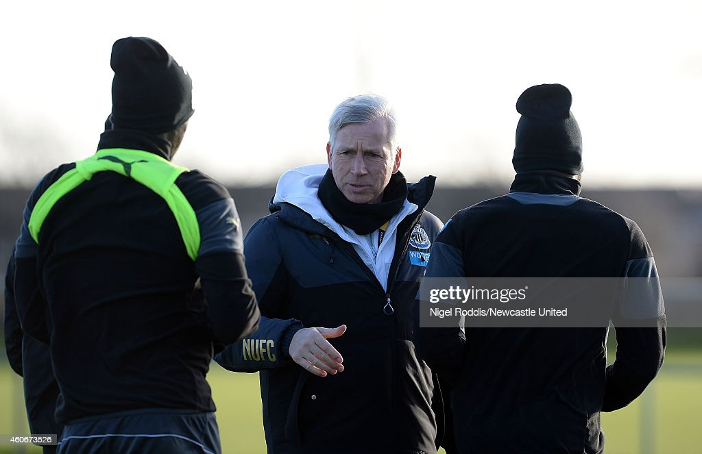 Alan Pardew manager (C) of Newcastle United speaks to players during a training session at The Newcastle United Training Centre on December 19, 2014 in Newcastle upon Tyne, England.