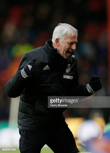 Alan Pardew Manager of West Bromwich Albion celebrates during the Premier League match between AFC Bournemouth and West Bromwich Albion at Vitality...