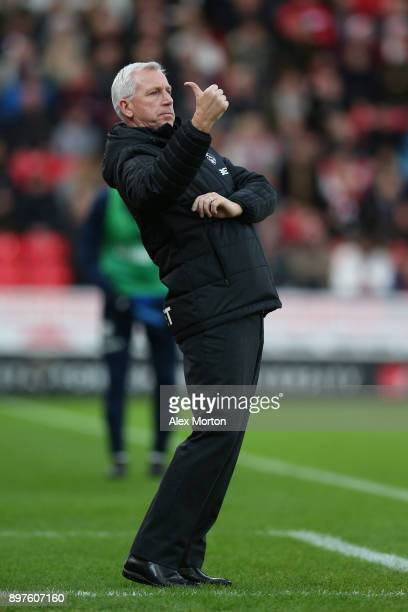 Alan Pardew Manager of West Bromwich Albion gives his team instructions during the Premier League match between Stoke City and West Bromwich Albion...