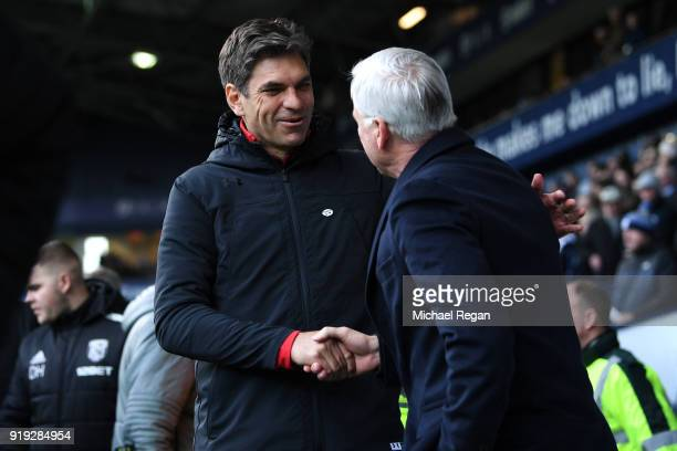 Alan Pardew Manager of West Bromwich Albion greets Mauricio Pellegrino Manager of Southampton prior to the The Emirates FA Cup Fifth Round between...