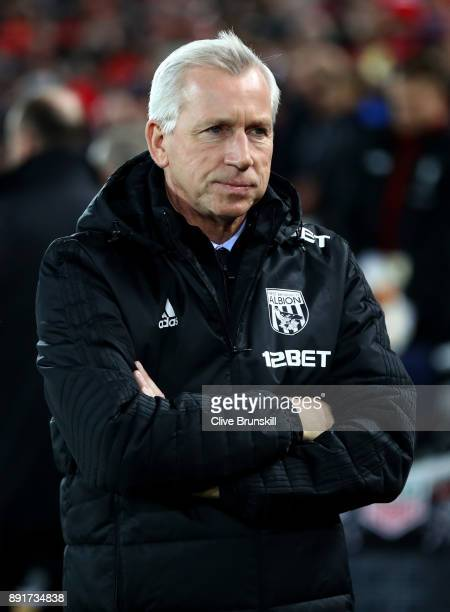 Alan Pardew Manager of West Bromwich Albion looks on prior to the Premier League match between Liverpool and West Bromwich Albion at Anfield on...