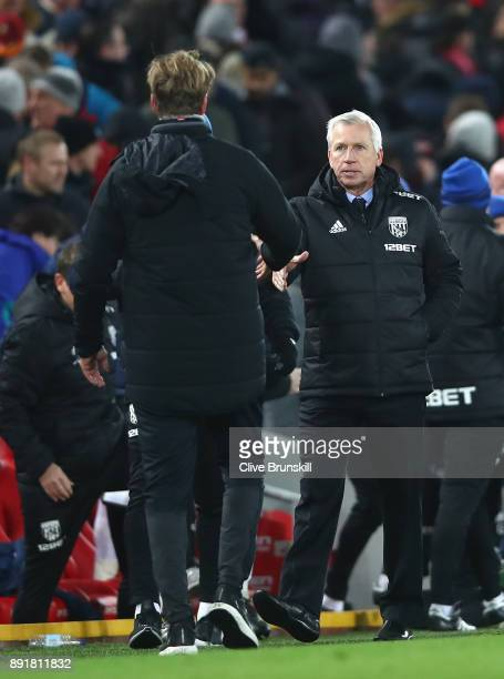 Alan Pardew Manager of West Bromwich Albion shakes hands with Jurgen Klopp Manager of Liverpool after the Premier League match between Liverpool and...