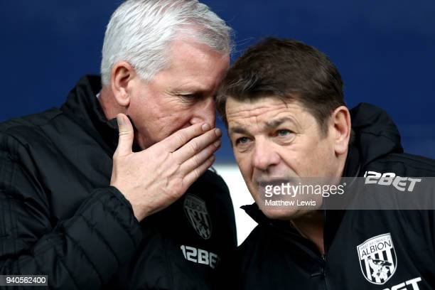 Alan Pardew Manager of West Bromwich Albion speaks to John Carver during the Premier League match between West Bromwich Albion and Burnley at The...