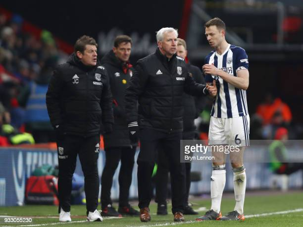 Alan Pardew Manager of West Bromwich Albion speaks to Jonny Evans of West Bromwich Albion during the Premier League match between AFC Bournemouth and...