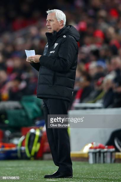Alan Pardew Manager of West Bromwich Albion takes notes during the Premier League match between Liverpool and West Bromwich Albion at Anfield on...