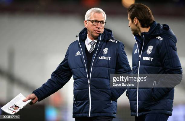 Alan Pardew Manager of West Bromwich Albion talks to Grzegorz Krychowiak prior to the Premier League match between West Ham United and West Bromwich...