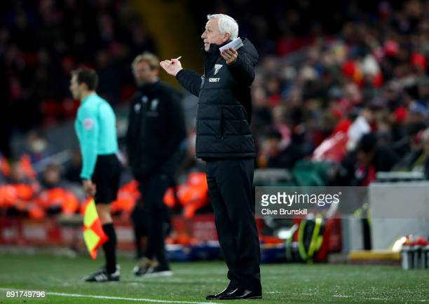Alan Pardew Manager of WestBromwich Albion gives his team instructions during the Premier League match between Liverpool and West Bromwich Albion at...