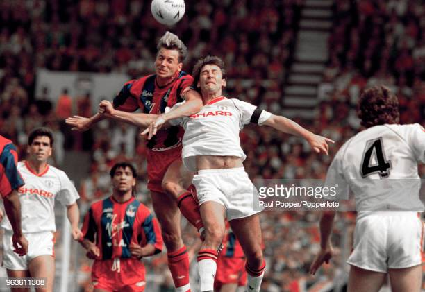 Alan Pardew of Crystal Palace and Bryan Robson of Manchester United battle for the ball during the FA Cup Final at Wembley Stadium on May 12 1990 in...