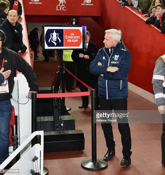 Alan Pardew of West Bromwich Albion consults the VAR system before The Emirates FA Cup Fourth Round match between Liverpool and West Bromwich Albion...