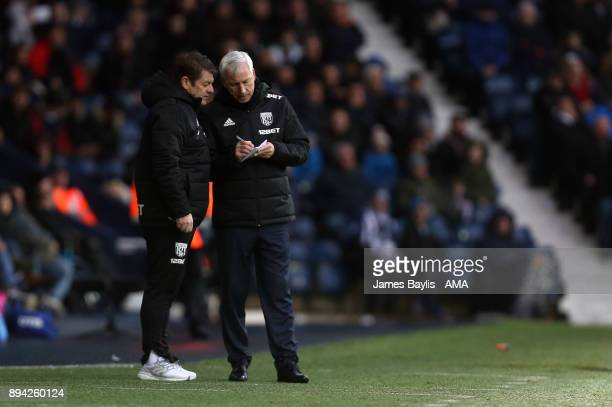Alan Pardew the head coach / manager of West Bromwich Albion with John Carver the first team coach of West Bromwich Albion during the Premier League...