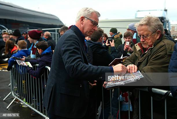 Alan Pardew the manager of Crystal Palace signs autographs as the team arrive at Turf Moor prior to the Barclays Premier League match between Burnley...