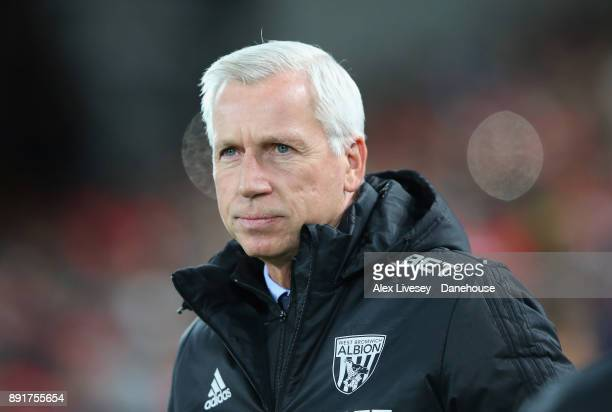 Alan Pardew the manager of West Bromwich Albion looks on during the Premier League match between Liverpool and West Bromwich Albion at Anfield on...