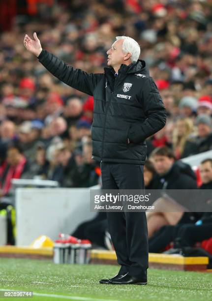 Alan Pardew the manager of West Bromwich Albion shouts instructions to his players during the Premier League match between Liverpool and West...
