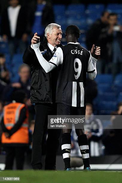 Alan Pardew the Newcastle manager celebrates with two goal hero Papiss Cisse of Newcastle after the final whistle during the Barclays Premier League...