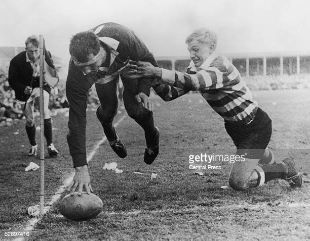 Alan Pask scores for the touring British Lions despite Dawie de Villiers attempt to stop him during a match against South Africa's Western Provinces...