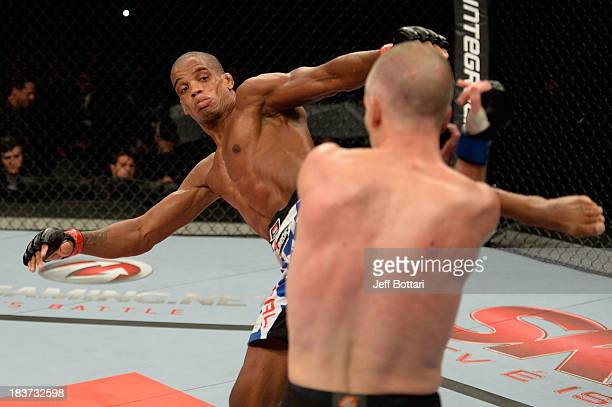 Alan Patrick kicks Garett Whiteley in their lightweight bout during the UFC Fight Night event at the Ginasio Jose Correa on October 9, 2013 in...