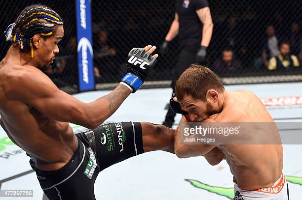 Alan Patrick of Brazil kicks Mairbek Taisumov of Russia in their lightweight bout during the UFC Fight Night event at the O2 World on June 20 2015 in...