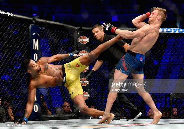Alan Patrick of Brazil kicks Scott Holtzman in their lightweight bout during the UFC 229 event inside TMobile Arena on October 6 2018 in Las Vegas...