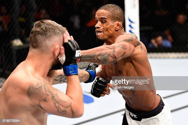 Alan Patrick of Brazil punches Damien Brown of Australia in their lightweight bout during the UFC Fight Night event at the Brisbane Entertainment...