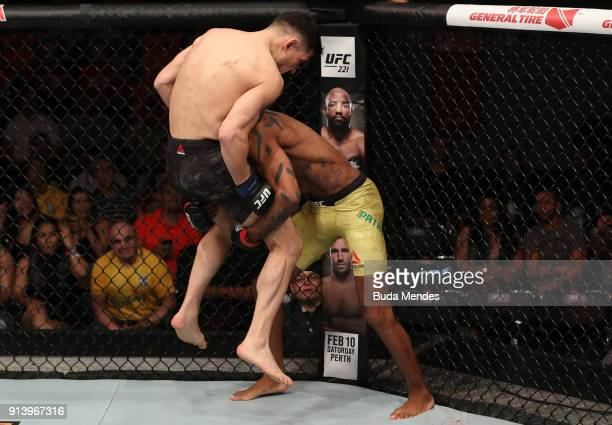 Alan Patrick of Brazil takes down Damir Hadzovic of Bosnia in their lightweight bout during the UFC Fight Night event at Mangueirinho Arena on...