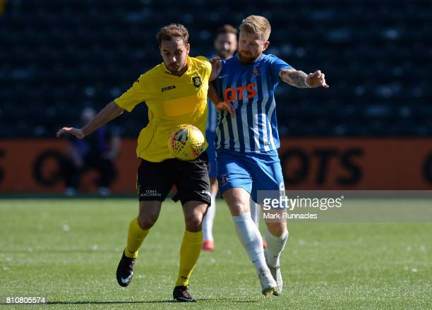 Alan Power of Kilmarnock is challenged by Scott Pittman of Livingston during the pre season friendly between Kilmarnock and Livingston at Rugby Park...