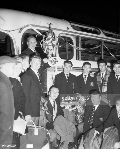 Alan Prescott holds the Rugby League Cup aloft as the St Helens team arrive at the Town Hall for a civic reception to celebrate their 132 victory...