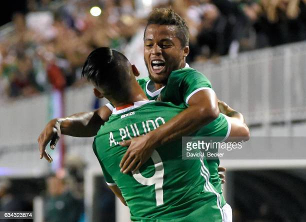 Alan Pulido and Giovani Dos Santos of Mexico celebrate a goal by Pulido during the first half of their exhibition match against Iceland at Sam Boyd...