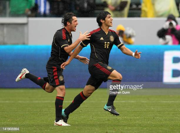 Alan Pulido and Israel Jimenez of Mexico celebrate after Pulido's second goal of the game against Honduras during the fourth day of 2012 CONCACAF...